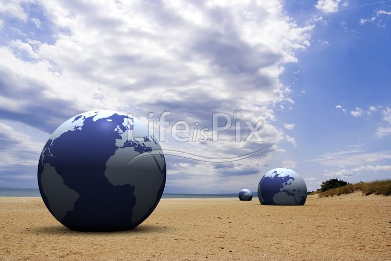 3d earth on sand under blue sky - Royalty free stock photos, illustrations and 3d letters fonts