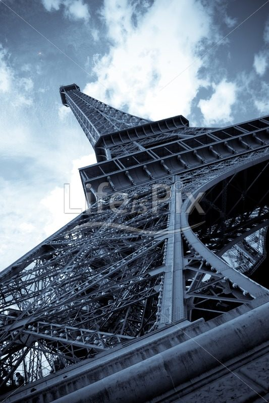 Eiffel tower in blue tones - Royalty free stock photos, illustrations and 3d letters fonts