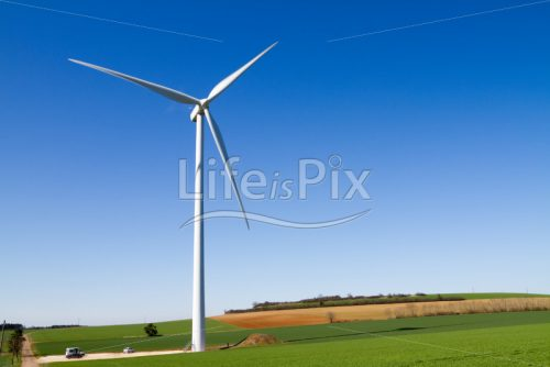 Wind turbine against clear blue sky - Royalty free stock photos, illustrations and 3d letters fonts