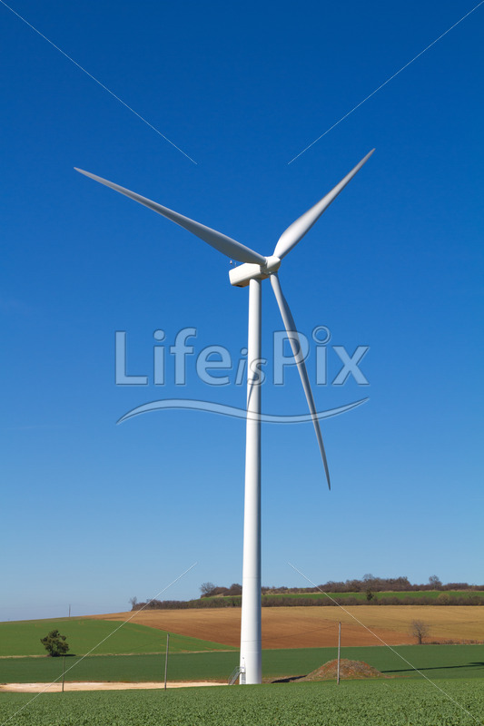 Wind turbine in rural landscape - Royalty free stock photos, illustrations and 3d letters fonts