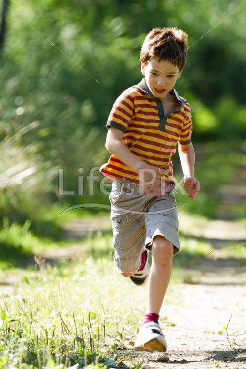 Young child running in forest in summer - Royalty free stock photos, illustrations and 3d letters fonts