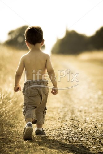 Young child walking on the road – Royalty free stock photos, illustrations and 3d letters fonts