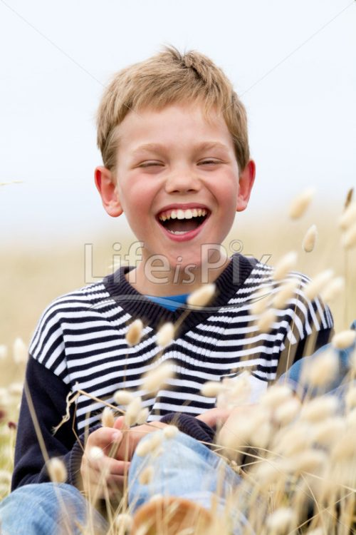 blond child laughing in nature – Royalty free stock photos, illustrations and 3d letters fonts