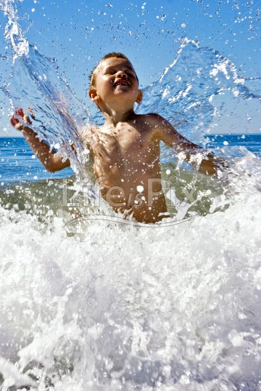 child playing in the waves – Royalty free stock photos, illustrations and 3d letters fonts
