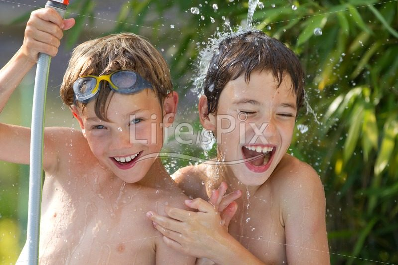 teenagers playing with garden hose and water - Royalty free stock photos, illustrations and 3d letters fonts