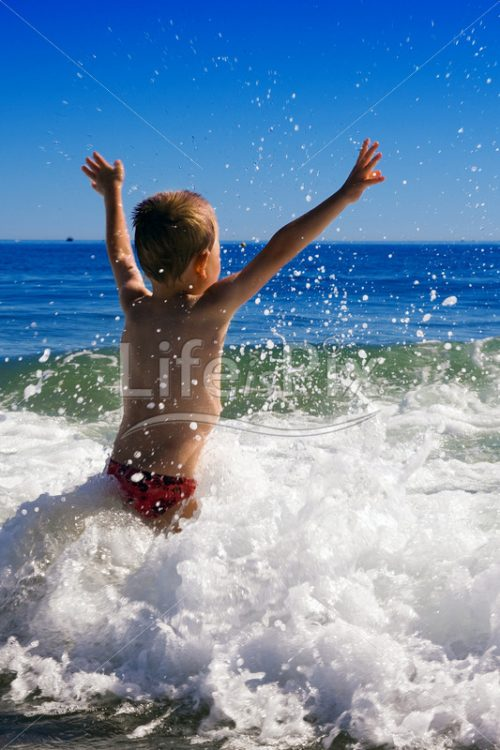 young child playing in the waves – holidays concept - Royalty free stock photos, illustrations and 3d letters fonts